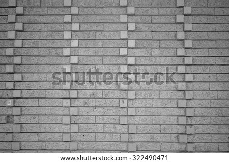 Exterior building wall with extended cube design in tones of black, white, and gray/grey, for use as an advertisement background/backdrop,  or for use as wallpaper.