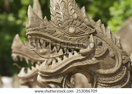 Exterior detail of the Naga (giant snake), protecting the Haw Phra Kaew temple in Vientiane, Laos. - stock photo