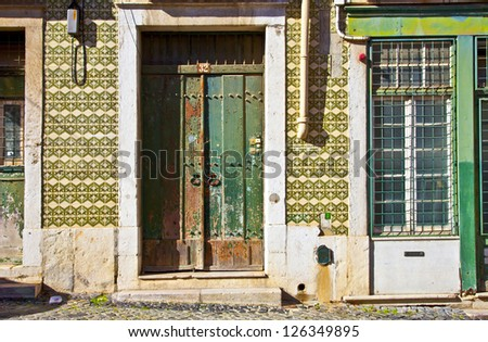 Exterior doors and tiled building in Lisbon, Portugal. - stock photo