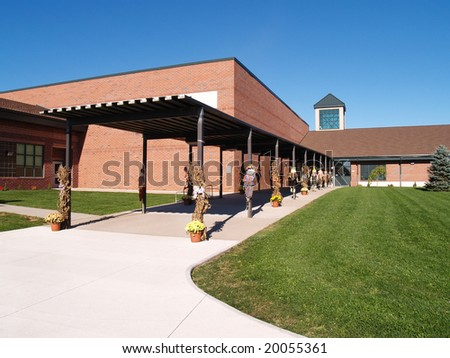 exterior entrance of elementary school decorated for Halloween - stock photo