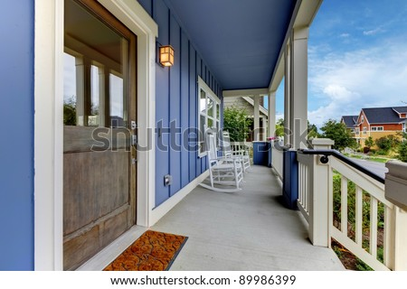Exterior from of the blue house porch.