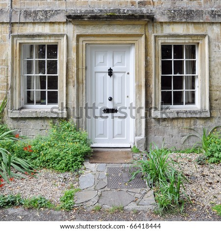 Exterior of a Beautiful Old Stone Cottage - stock photo