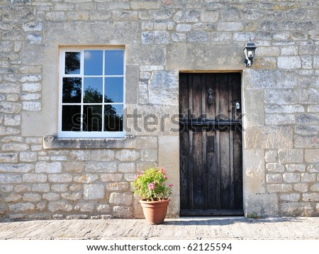 Exterior of a Beautiful Stone Cottage - stock photo