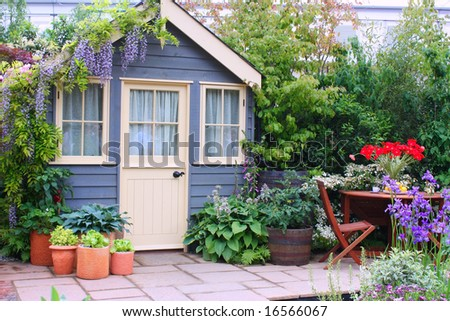 Exterior of a house with beautiful garden - stock photo