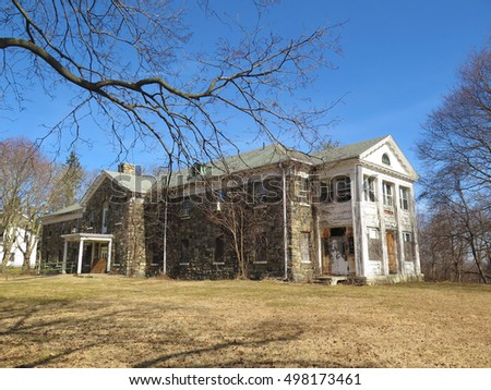 Exterior of a large, abandoned psychiatric hospital