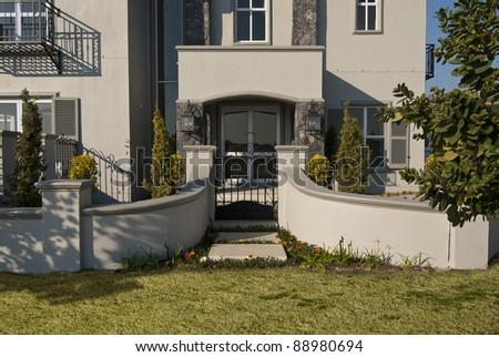 Exterior of a luxury house on a sunny day - stock photo