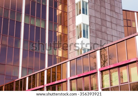 exterior of a modern office building with brown glass - stock photo