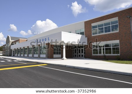 exterior of a modern school building entrance - stock photo