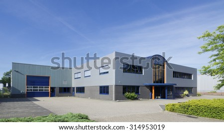 exterior of a modern warehouse building with office - stock photo