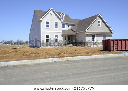 exterior of a new two story home under construction - stock photo