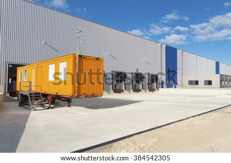 exterior of a newly build warehouse with loading docks