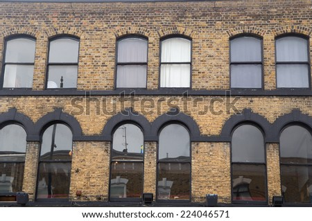 exterior of a old warehouse - stock photo