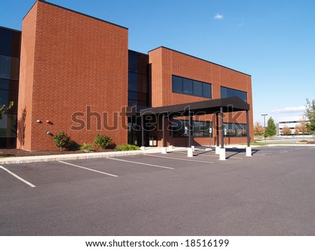exterior of a red brick modern office building - stock photo
