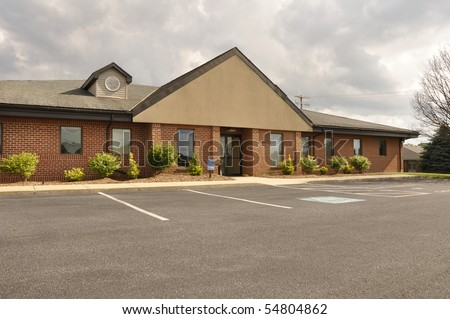 Exterior of a small one-story office building. - stock photo