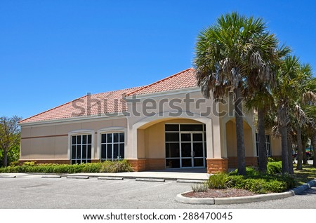 Exterior of a Vacant Commercial Building for Sale or Lease - stock photo
