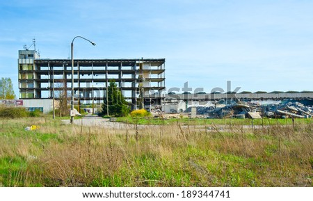 Exterior of an abandoned factory building - stock photo