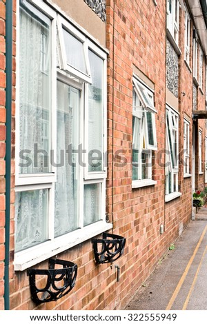 Exterior of an apartment building with open and closed windows - stock photo