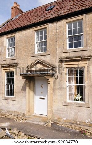 Exterior of an Old English Cottage Built Circa 1730 - stock photo