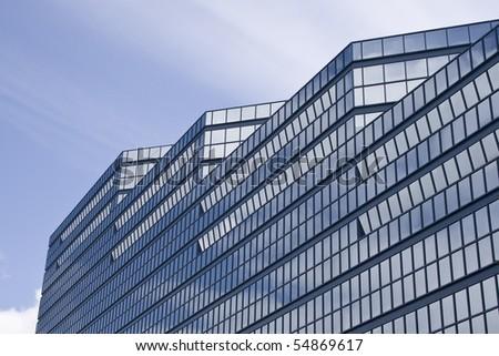 Exterior of contemporary glass business center - stock photo
