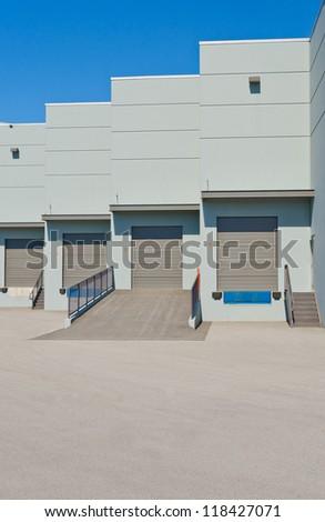 Exterior of loading docks, bay. - stock photo