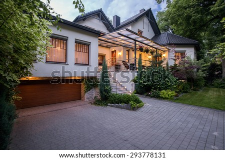 Exterior of luxury residence with cozy terrace - stock photo