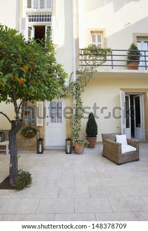 Exterior of mansion with garden - stock photo