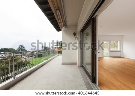 Exterior of modern apartment with wooden floor