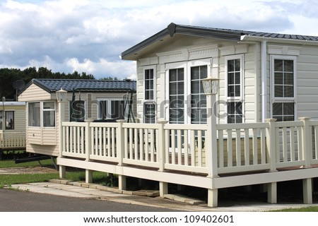 Exterior of modern caravan, mobile home or trailer in park, Generic image of one available for hire. - stock photo