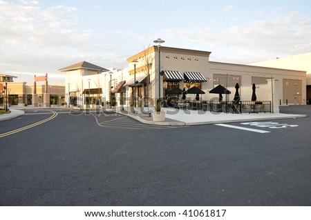 Exterior of several storefronts for a shopping area. - stock photo