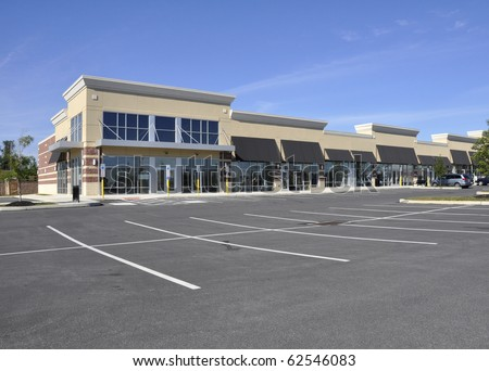 Exterior of several storefronts for a shopping area.  Image taken from a public access area. - stock photo