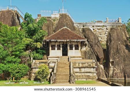 Exterior of the entrance to the Isurumuniya rock temple in Anuradhapura, Sri Lanka.  - stock photo