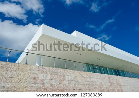 Exterior of the modern style building.  Manicured shrubs lines. - stock photo