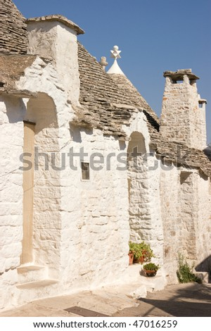 Exterior of traditional trulli houses in Alberobello (Puglia, Italy). These dry-stone houses with conical roofs are characteristic of middle-southern Apulia and are protected under UNESCO heritage law