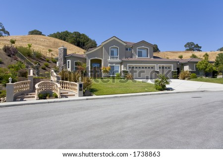 Exterior shot of a large luxurious home.