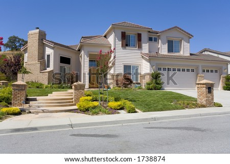 Exterior shot of a large luxurious home. - stock photo