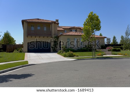 Exterior shot of a recently constructed large Spanish styled Villa. - stock photo