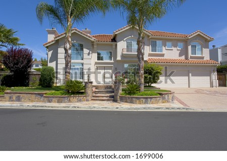 exterior shot of a very nice, upscale Mediterranean styled home. - stock photo