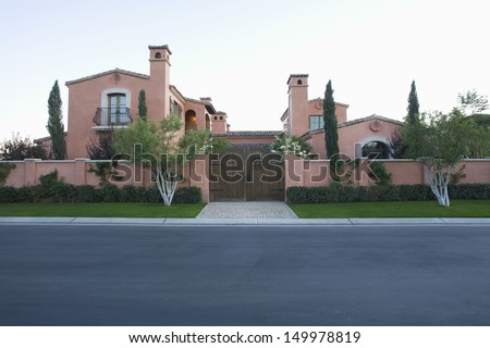 Exterior shot of hacienda against clear sky from highway - stock photo