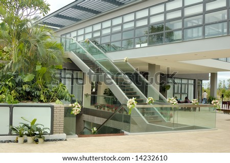 Exterior Staircase and glass wall viewed from a opening hall - stock photo