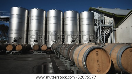 Exterior summer shot of wine silos and barrels at Cloudy Bay winery in New Zealand. - stock photo