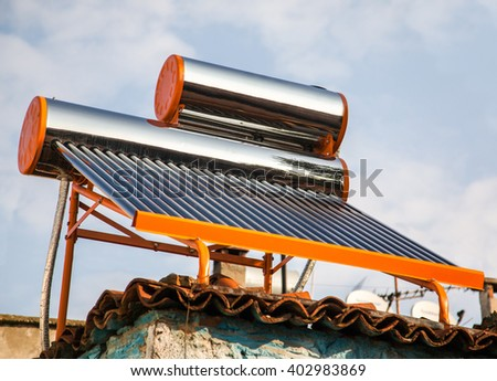exterior sun hot water system and storage - stock photo