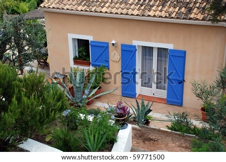 Exterior terrace with blue doors and window - stock photo