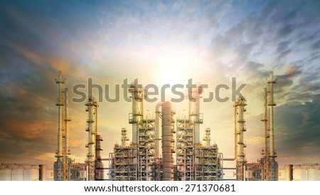 exterior tube of petrochemical plant and oil refinery for produce industrial material in heavy petroleum industry estate against beautiful sun light sky  - stock photo