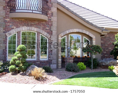 Exterior view of a large luxurious home - stock photo