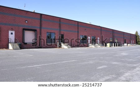 exterior view of a large warehouse building - stock photo