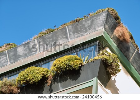 Exterior view of a Luxury Rooftop penthouse apartment terrace with green garden - stock photo