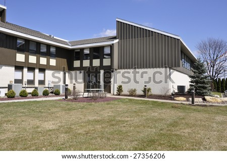 exterior view of a modern two story office building - stock photo