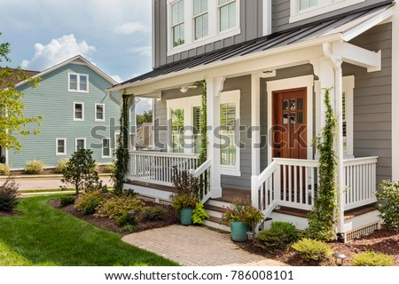 Exterior view of an upscale house with a really nice beautifully landscaped front yard
