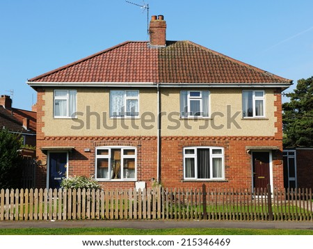 Exterior View of Houses on a Typical Inner City English Residential Estate - The Estate was Built Circa 1960 During a Boom in Social Housing - stock photo