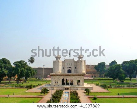 Exterior View of Lahore Fort (Shahi Qilla) with small garden in foreground. Lahore Fort is located opposite to Badshahi Mosque in Lahore and is one of the most visited tourist destination. - stock photo